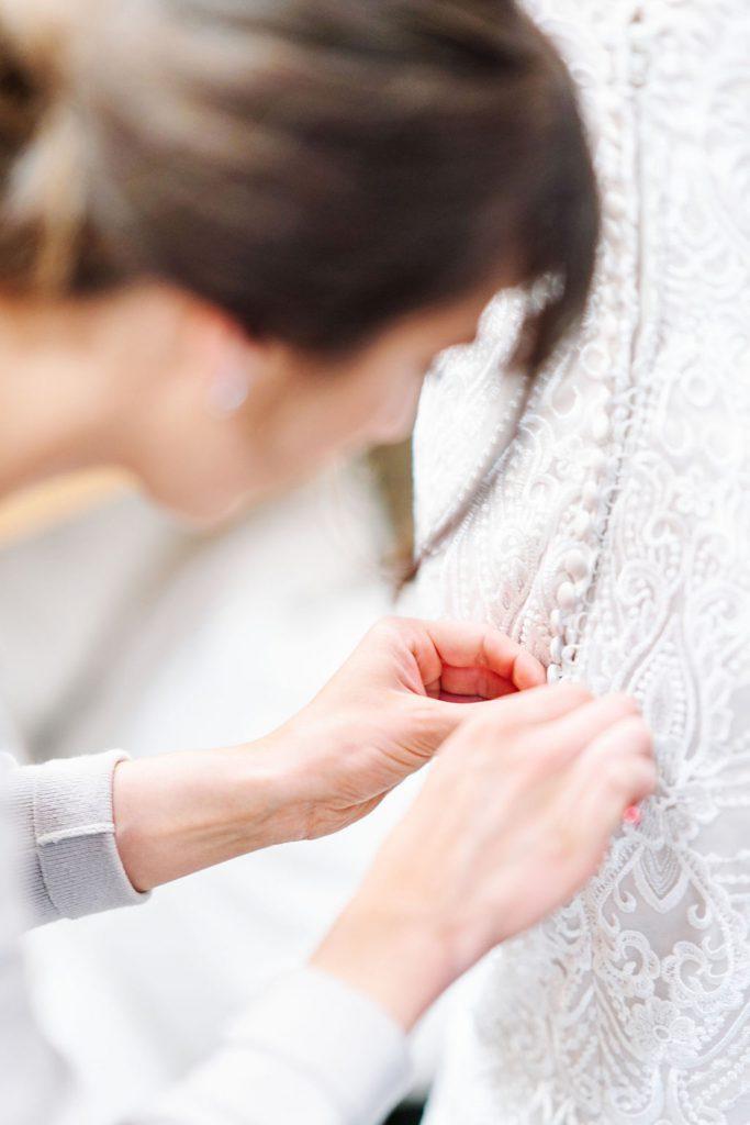 Getting Into Wedding Dress   Minneapolis Wedding Photographer   Minnetonka St. Therese Wedding Hilton Minneapolis Bloomington